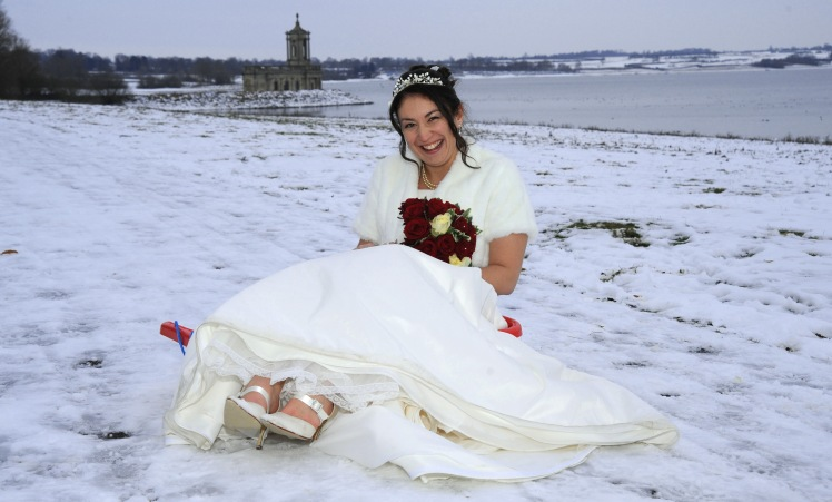 Normanton Church and bride at a winter wedding in Rutland